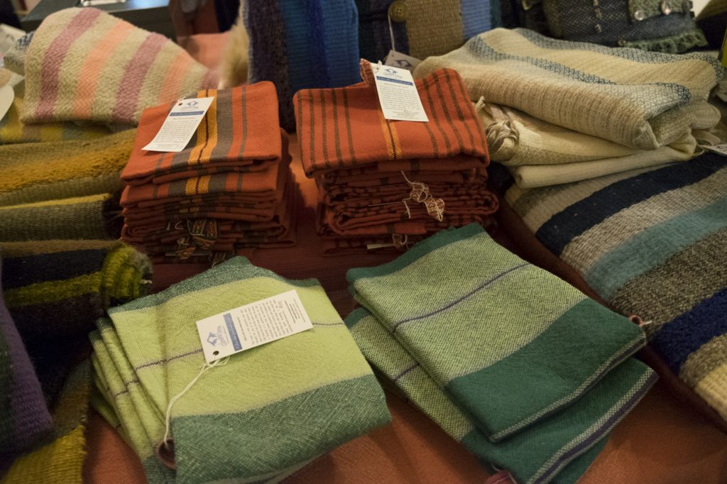 A stack of handwoven towels in red and green.