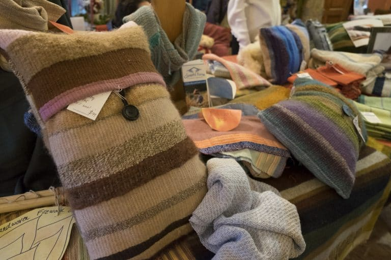 Glenora Farm handwoven pillows are displayed for sale.